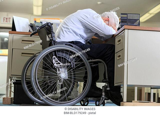 Caucasian businessman resting on office desk
