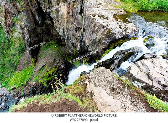 Iceland, waterfall from above, Svartifoss (black waterfall, according to the color of the surrounding rock) is located in the Skaftafell National Park in...