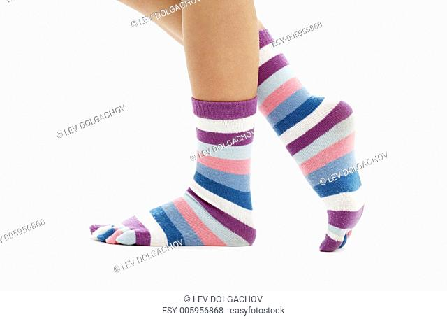 beautiful legs in funny socks over white