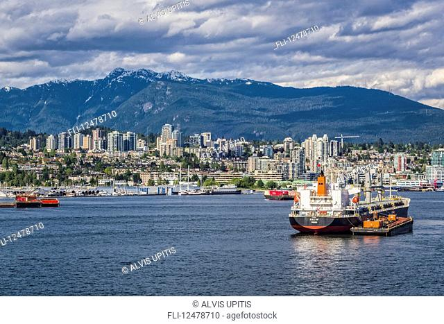Cargo ships in the Vancouver harbour; Vancouver, British Columbia, Canada
