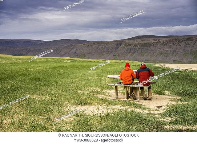 People having a picnic by the coast, Patreksfjordur, West Fjords, Iceland
