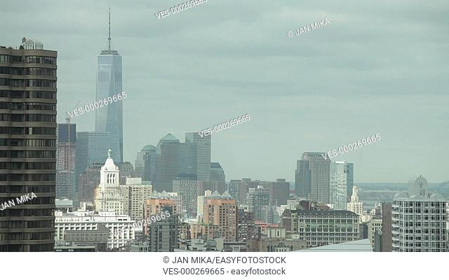 Time lapse of Lower Manhattan skyline with cloudy sky in New York City, USA