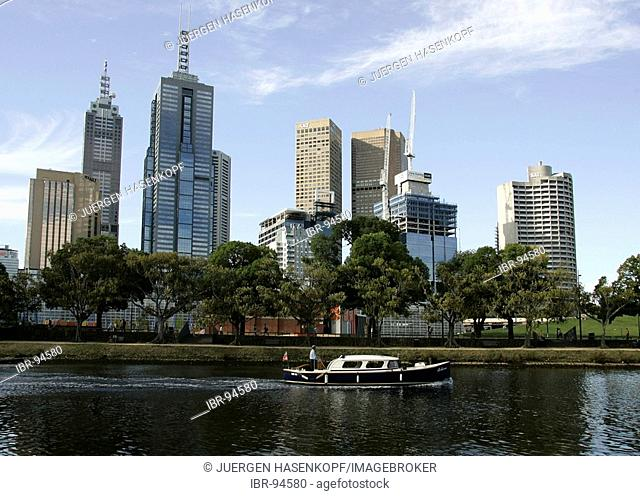 Water taxi at the southbank promenade on the Yarra River with the city skyline in the background, Melbourne, Victoria, Australia
