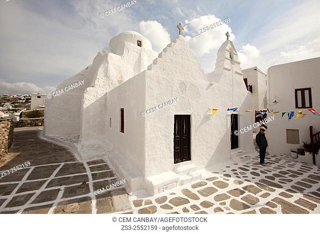 Tourist in front of the Church of Paraportiani, Mykonos, Cyclades Islands, Greek Islands, Greece, Europe