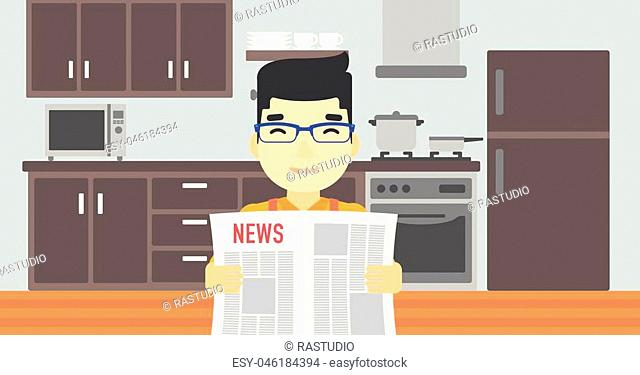 An asian happy man reading the newspaper. Young smiling man reading good news. Man with newspaper in hands on the background of kitchen