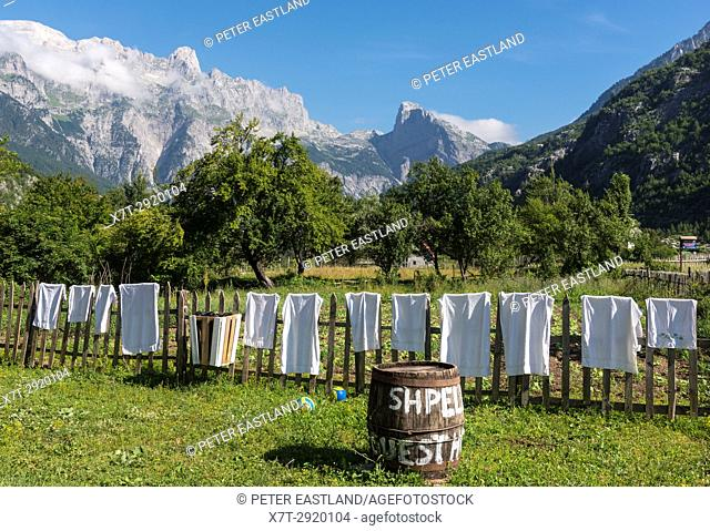 Washing drying on a fence in the village of Theth, with the Albanian Alps in the background, Northern Albania
