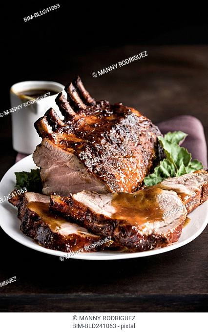 Sliced rack of pork on plate