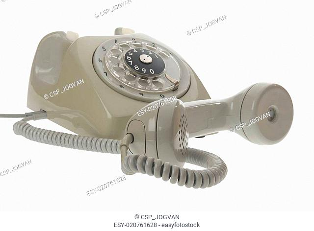 Old vintage rotary style telephone - handset off