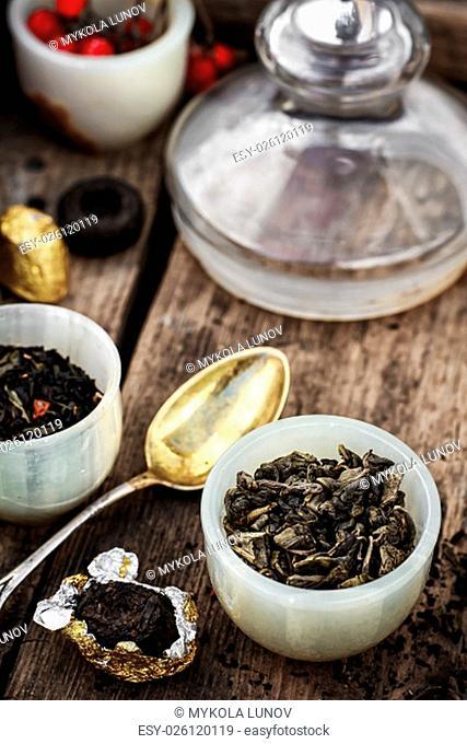Tea leaves of different varieties in the stacks of custard