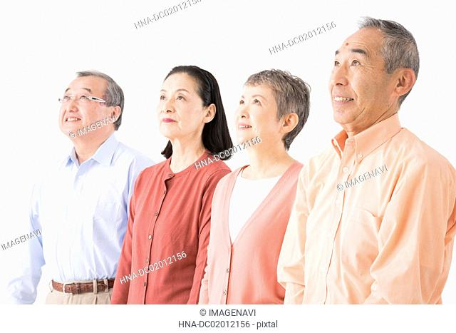 Four senior men and women looking up