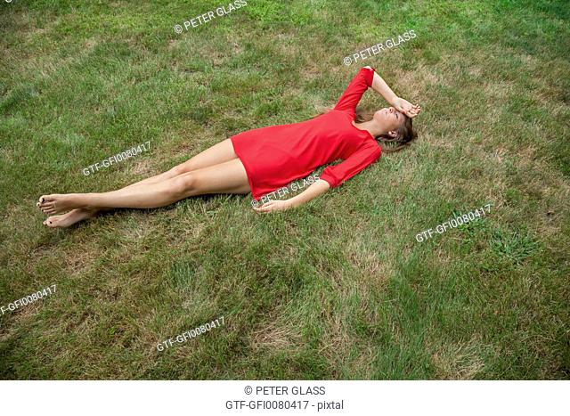 Teenage girl lying on the ground