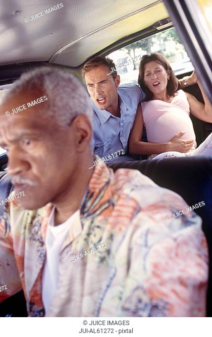 Taxi driver with pregnant woman and husband