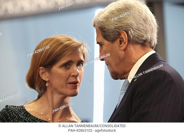 United States Ambassador to the United Nations Samantha Power, left, speaks with U.S. Secretary of State John Kerry, right, as U.S