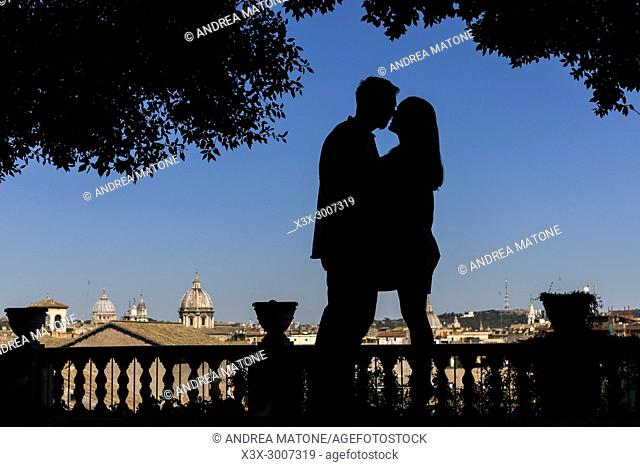 Silhouette couple kissing in Rome Italy