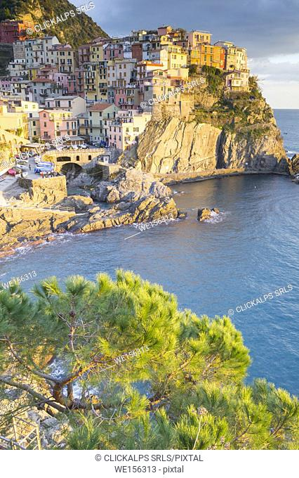 Sunset over the typical colored coastal village of Manarola, Cinque Terre, Italy