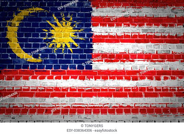 An image of the Malaysia flag painted on a brick wall in an urban location
