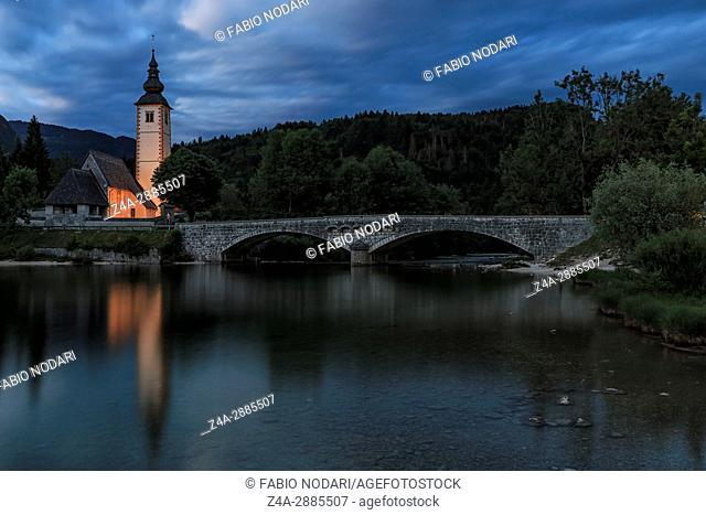 Bohinj, Slovenia - June 5, 2017: Church of St John the Baptist in Lake Bohinj, a famous destination not far from lake Bled in Slovenia, at sunset
