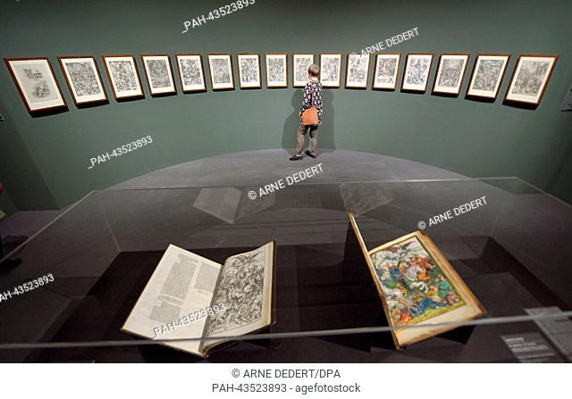 A woman looks at the 'Apocalypse' (1498/1511) by Albrecht Duerer at the Staedel Museum in Frankfurt Main, Germany, 22 October 2013