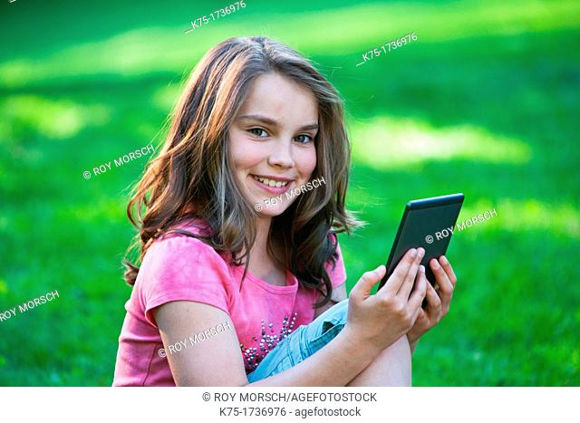 Young girl reading e-reader