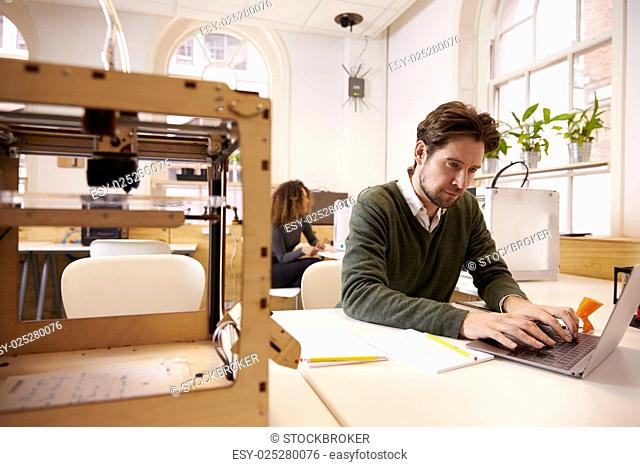 Designer Working With 3D Printer And CAD Software In Studio