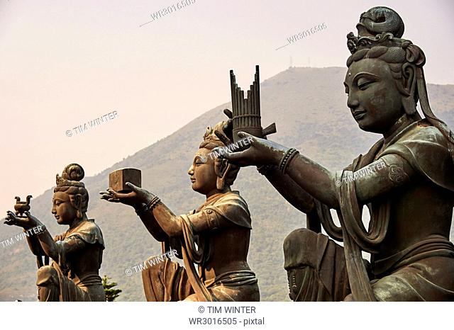Supporting figures make offerings to Big Buddha, Po Lin Monastery, Ngong Ping, Lantau Island, Hong Kong, China, Asia