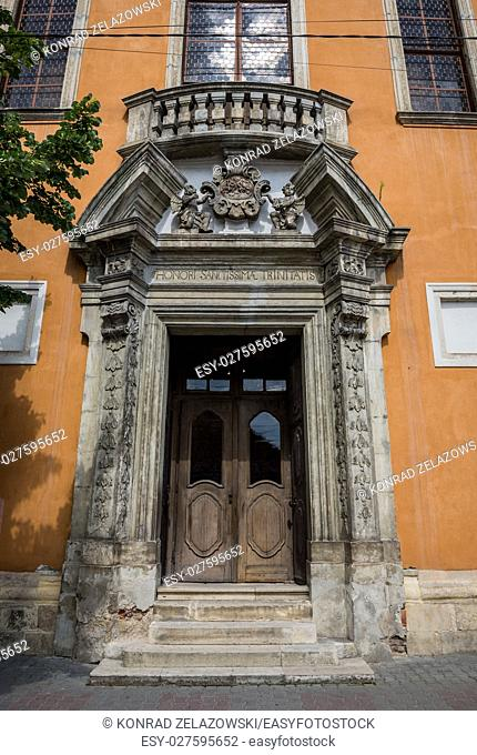 Entrance portal of Church of The Holy Trinity in Cluj-Napoca city in Romania