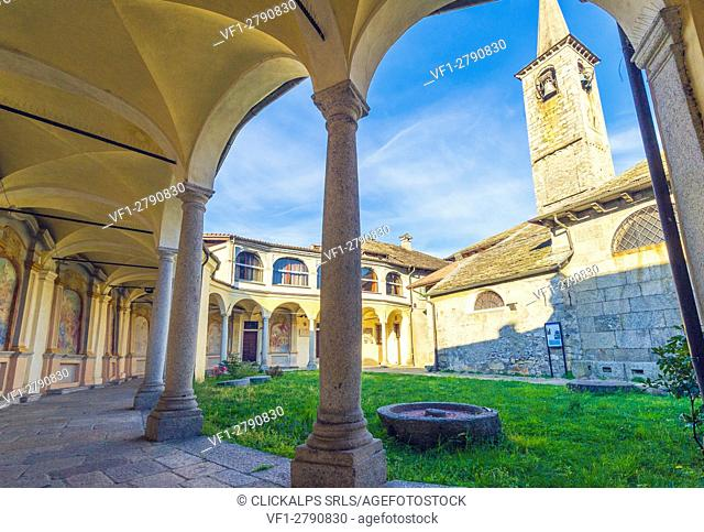 Mergozzo, lake Mergozzo, Piedmont, Italy. Church and its old cloister with paintings and arcades