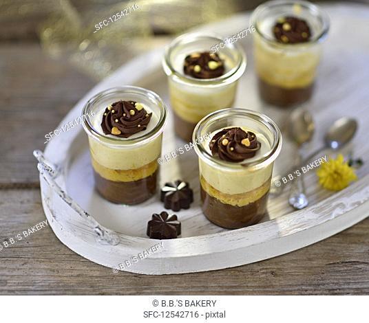 Vegan pumpkin and chocolate cheesecake dessert with chocolate cream swirls