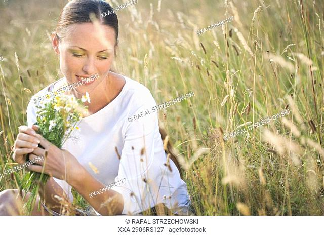woman on filed with flowers