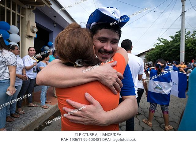 11 June 2019, Nicaragua, Managua: Cristian Fajardo (r), prominent leader of the protests against the government, embraces a friend after his release from prison