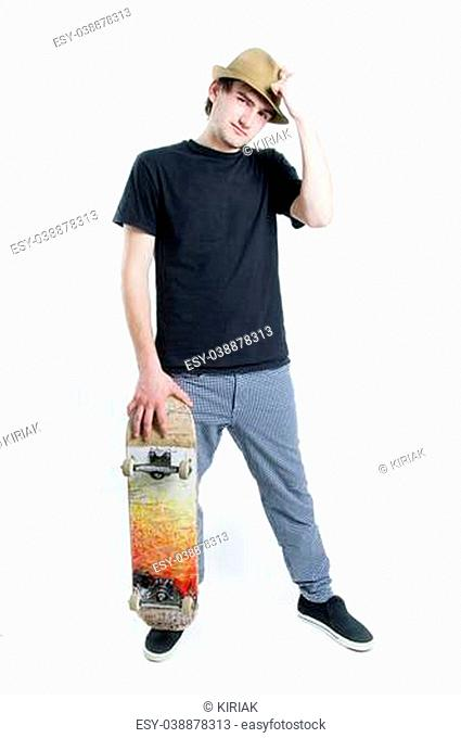 Serious looking teenager with skate isolated on white background