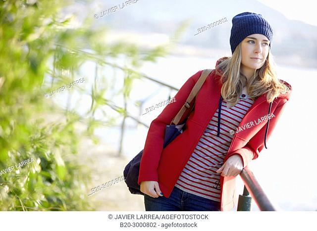 Adult woman at the coast of Santa Clara Island, Donostia, San Sebastian, Gipuzkoa, Basque Country, Spain, Europe, Winter