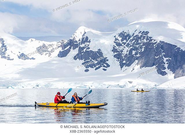 Kayakers in ice at Danco Island, Errera Channel, Western side of the Antarctic Peninsula, Antarctica