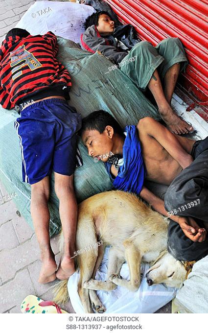 Street children sleeping on the street