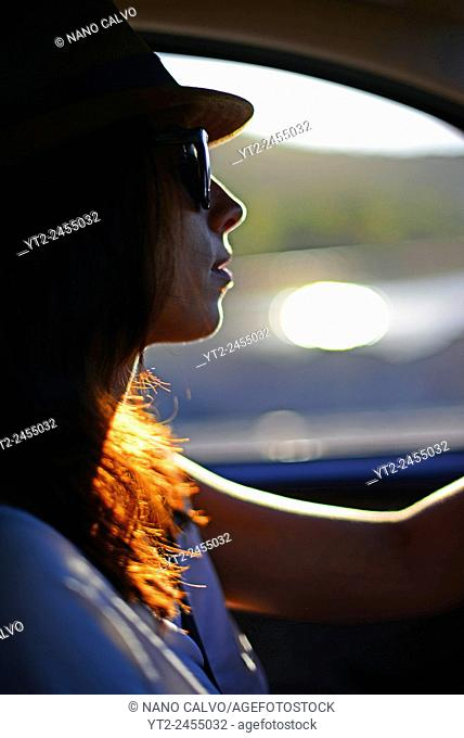 Young woman driving car in Ibiza, Balearic Islands, Spain