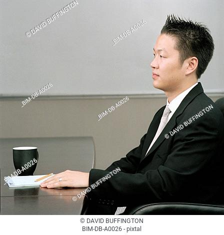 Businessman sitting at a conference table