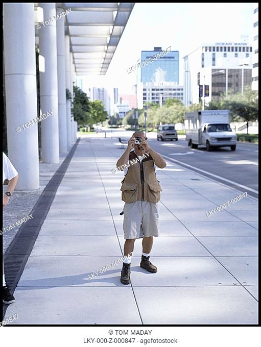 Man taking snapshot of photographer
