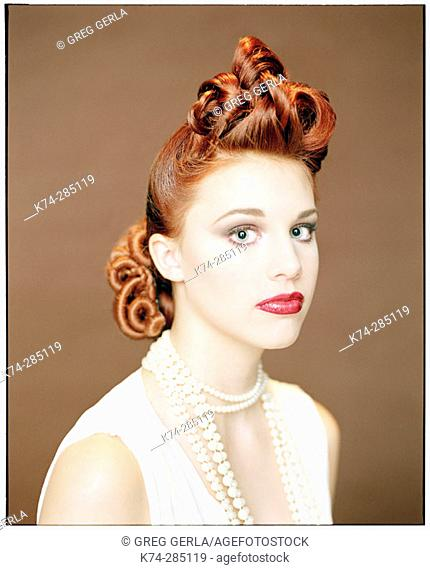 Portrait of Young Woman With Vintage Hairstyle
