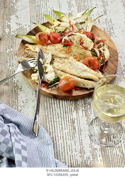 Grilled barramundi with fennel, cauliflower, cherry tomatoes and chillies
