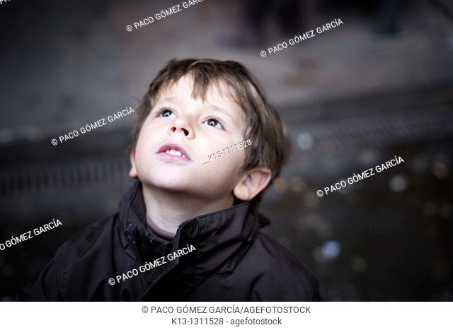 Child looking at the sky