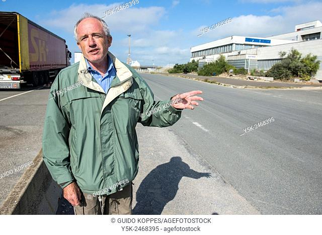 Terminal E, Calais, France. Local inhabitant of Calais, wandering the former ferry terminal, explaining the crisis with illegal immigrants