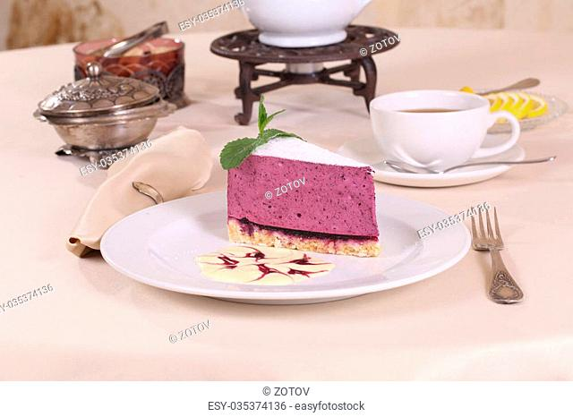 blueberry cheesecake and tea with lemon and sugar