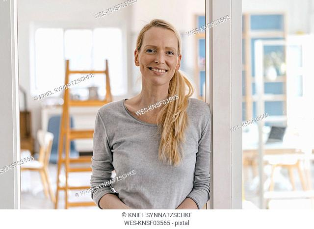 Portrait of smiling woman in a loft
