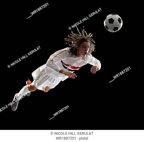 Soccer player heading the ball