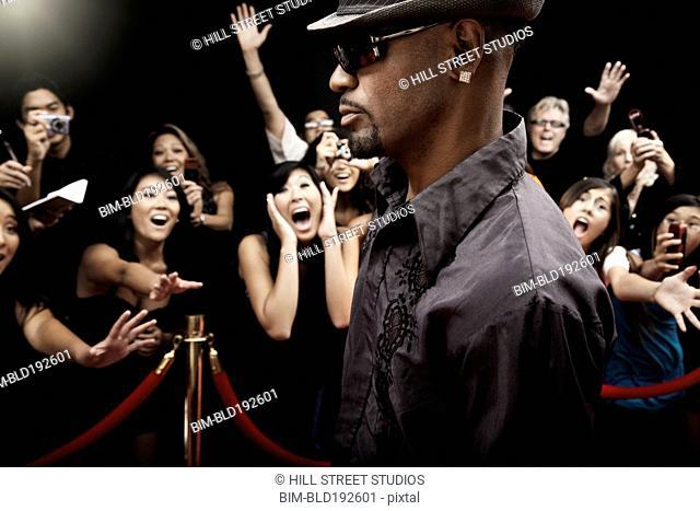 African celebrity arriving on red carpet