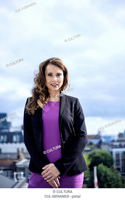 Portrait of businesswoman, outdoors
