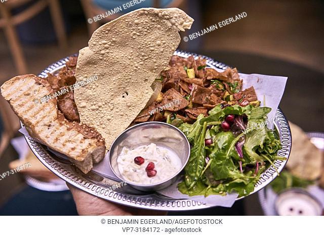 dishes in vegan, oriental restaurant Kismet, Munich, Germany