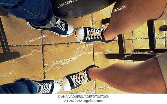 Couple sitting playing with feet, Miajadas, Spain