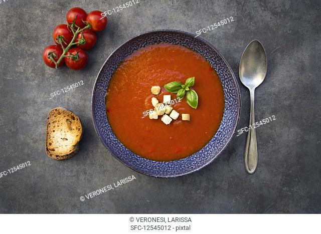 Tomato soup with basil, croutons and grilled baguette