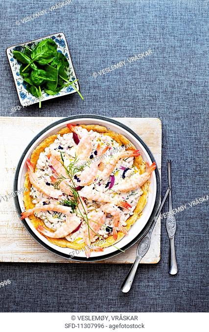 Seafood pie with red onions, caviar and dill